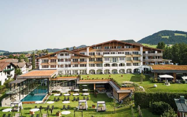 4 star Hotel Rosenalp exterior view in the summer